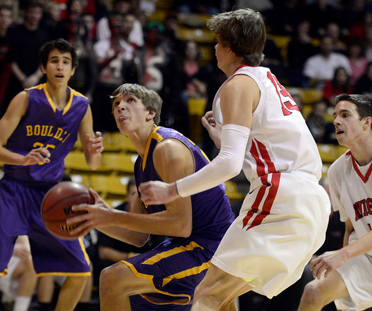 Boulder's RJ Lampert goes to the basket against Fairview's Sam Martin in the first quarter Saturday night Jan. 19, 2013 at the Coors Events Center. (Lewis Geyer/Times-Call)