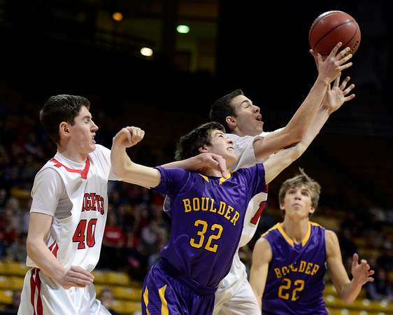 Boulder's Cooper Bohm battles for the ball against Fairview's Miles MacKenzie, left, and Trevor McQueeney Saturday night Jan. 19, 2013 at the Coors Events Center. (Lewis Geyer/Times-Call)