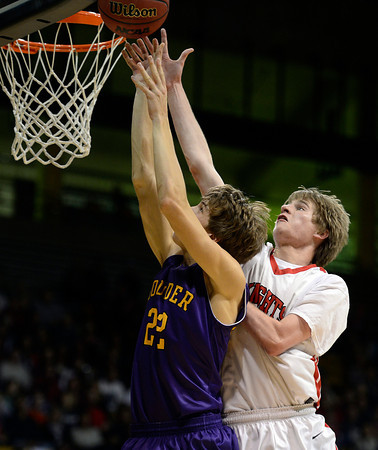 Fairview's Brent Wrapp fouls Boulder's RJ Lampert in the second quarter Saturday night Jan. 19, 2013 at the Coors Events Center. (Lewis Geyer/Times-Call)