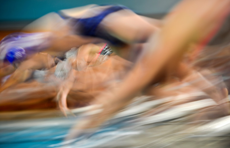 "Swimmers dive off the blocks during the swim meet at Centennial Pool in Longmont on Thursday, Dec. 6, 2012. For more photos visit  <a href=""http://www.BoCoPreps.com"">http://www.BoCoPreps.com</a>.<br /> (Greg Lindstrom/Times-Call)"