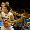 The University of Colorado's Askia Booker drives to the basket between UCLA's Norman Powell, left, and Larry Drew in the first half Saturday Jan. 12, 2013 at the Coors Events Center. (Lewis Geyer/Times-Call)