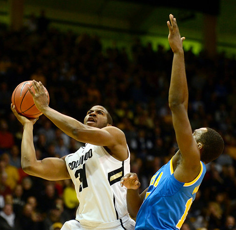 The University of Colorado's Jeremy Adams takes a shot in front of UCLA's Shabazz Muhammad in the first half Saturday Jan. 12, 2013 at the Coors Events Center. (Lewis Geyer/Times-Call)