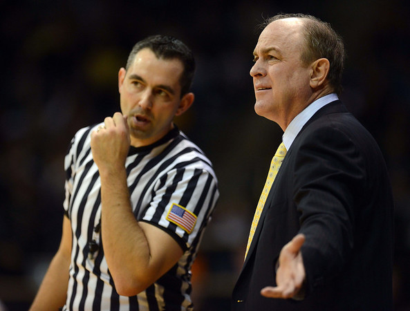 UCLA head coach Ben Howland has words with a referee in the first half Saturday Jan. 12, 2013 at the Coors Events Center. (Lewis Geyer/Times-Call)