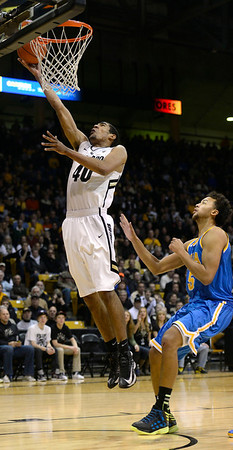 The University of Colorado's Josh Scott makes a lay up in front of UCLA's Kyle Anderson in the first half Saturday Jan. 12, 2013 at the Coors Events Center. (Lewis Geyer/Times-Call)