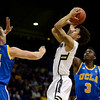 The University of Colorado's Askia Booker takes a shot between UCLA's Travis Wear, left, Jordan Adams in the first half Saturday Jan. 12, 2013 at the Coors Events Center. (Lewis Geyer/Times-Call)