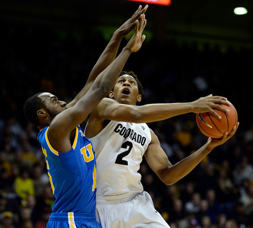 The University of Colorado's Xavier Johnson is fouled by UCLA's Shabazz Muhammad in the first half Saturday Jan. 12, 2013 at the Coors Events Center. (Lewis Geyer/Times-Call)