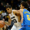 The University of Colorado's Josh Scott is defended by UCLA's Kyle Anderson in the first half Saturday Jan. 12, 2013 at the Coors Events Center. (Lewis Geyer/Times-Call)
