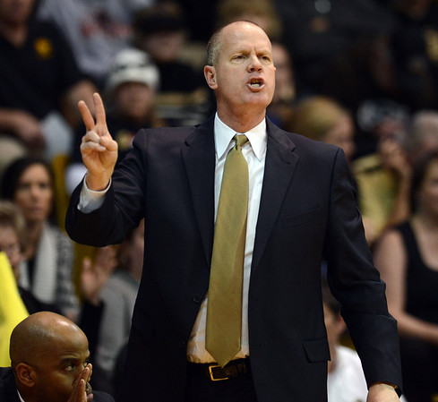 University of Colorado head coach Tad Boyle signals to his team in the second half against UCLA Saturday Jan. 12, 2013 at the Coors Events Center. (Lewis Geyer/Times-Call)