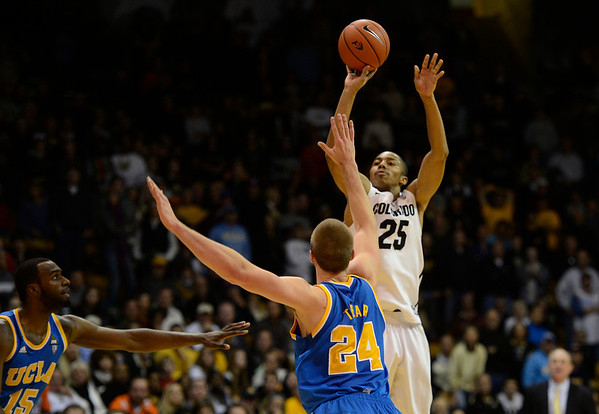 The University of Colorado's Spencer Dinwiddie sinks a three-pointer in the final 30 seconds of the game against UCLA Saturday Jan. 12, 2013 at the Coors Events Center. CU lost 78-75. (Lewis Geyer/Times-Call)