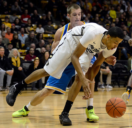 The University of Colorado's Andre Roberson drives the ball in front of UCLA's Travis Wear in the first half Saturday Jan. 12, 2013 at the Coors Events Center. (Lewis Geyer/Times-Call)
