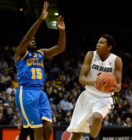 The University of Colorado's Xavier Johnson looks for a shot against UCLA's Shabazz Muhammad in the first half Saturday Jan. 12, 2013 at the Coors Events Center. (Lewis Geyer/Times-Call)