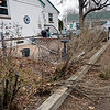 "Damage to a neighboring fence after a car ran into the house at 914 Collyer St. in Longmont on Monday, Dec. 24, 2012.  For more photos and a video visit  <a href=""http://www.TimesCall.com"">http://www.TimesCall.com</a>.<br /> (Greg Lindstrom/Times-Call)"