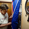 "Ken Barkman pulls back a tarp to show damage to a room after a car ran into his house at 914 Collyer St. in Longmont on Monday, Dec. 24, 2012. For more photos and a video visit  <a href=""http://www.TimesCall.com"">http://www.TimesCall.com</a>.<br /> (Greg Lindstrom/Times-Call)"