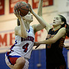 """Centaurus' Taylor Langer (4) shoots over Mead's Mikayla Martinez (5) during the game at Centaurus High School on Friday, March 1, 2013. Centaurus beat Mead 48-30. For more photos visit  <a href=""""http://www.BoCoPreps.com"""">http://www.BoCoPreps.com</a>.<br /> (Greg Lindstrom/Times-Call)"""