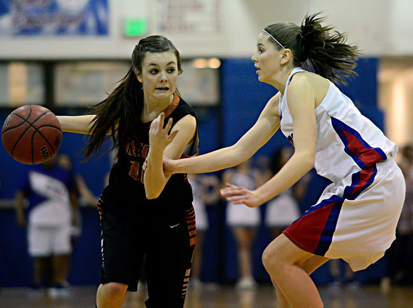 "Mead's Rylee Ward (24) drives past Centaurus' Lyndie Puckett (3) during the game at Centaurus High School on Friday, March 1, 2013. Centaurus beat Mead 48-30. For more photos visit  <a href=""http://www.BoCoPreps.com"">http://www.BoCoPreps.com</a>.<br /> (Greg Lindstrom/Times-Call)"