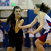 """Mead's Rylee Ward (24) drives past Centaurus' Lyndie Puckett (3) during the game at Centaurus High School on Friday, March 1, 2013. Centaurus beat Mead 48-30. For more photos visit  <a href=""""http://www.BoCoPreps.com"""">http://www.BoCoPreps.com</a>.<br /> (Greg Lindstrom/Times-Call)"""