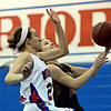 """Centaurus' Anna Hubbell (23) tries to block a shot by Mead's Marina Hanlon (14) during the game at Centaurus High School on Friday, March 1, 2013. Centaurus beat Mead 48-30. For more photos visit  <a href=""""http://www.BoCoPreps.com"""">http://www.BoCoPreps.com</a>.<br /> (Greg Lindstrom/Times-Call)"""