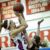 """Centaurus' Anna Hubbell (23) shoots over Mead's Allison Majerus (20) during the game at Centaurus High School on Friday, March 1, 2013. Centaurus beat Mead 48-30. For more photos visit  <a href=""""http://www.BoCoPreps.com"""">http://www.BoCoPreps.com</a>.<br /> (Greg Lindstrom/Times-Call)"""