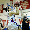 """Mead's Kari Lozinski (23) blocks a shot by Centaurus' Shanlie Anderson (5) during the game at Centaurus High School on Friday, March 1, 2013. Centaurus beat Mead 48-30. For more photos visit  <a href=""""http://www.BoCoPreps.com"""">http://www.BoCoPreps.com</a>.<br /> (Greg Lindstrom/Times-Call)"""