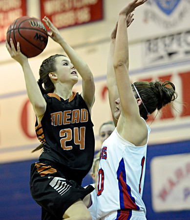 """Mead's Rylee Ward (24) shoots over Centaurus' Gianna Manfredini (10) during the game at Centaurus High School on Friday, March 1, 2013. Centaurus beat Mead 48-30. For more photos visit  <a href=""""http://www.BoCoPreps.com"""">http://www.BoCoPreps.com</a>.<br /> (Greg Lindstrom/Times-Call)"""