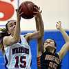 """Centaurus' Midori Patterson (15) grabs a rebound over Mead's Fei Daly (10) during the game at Centaurus High School on Friday, March 1, 2013. Centaurus beat Mead 48-30. For more photos visit  <a href=""""http://www.BoCoPreps.com"""">http://www.BoCoPreps.com</a>.<br /> (Greg Lindstrom/Times-Call)"""