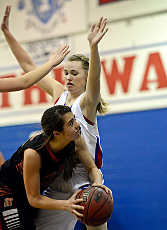 "Mead's Kasey McKrola looks to shoot over Centaurus' Natalie Gofran during the game at Centaurus High School on Friday, March 1, 2013. Centaurus beat Mead 48-30. For more photos visit  <a href=""http://www.BoCoPreps.com"">http://www.BoCoPreps.com</a>.<br /> (Greg Lindstrom/Times-Call)"