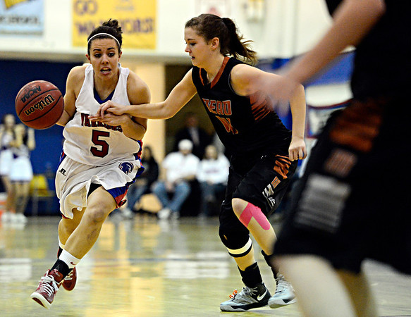 "Centaurus' Shanlie Anderson (5) drives past Mead's Marina Hanlon (14) during the game at Centaurus High School on Friday, March 1, 2013. Centaurus beat Mead 48-30. For more photos visit  <a href=""http://www.BoCoPreps.com"">http://www.BoCoPreps.com</a>.<br /> (Greg Lindstrom/Times-Call)"