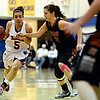 """Centaurus' Shanlie Anderson (5) drives past Mead's Marina Hanlon (14) during the game at Centaurus High School on Friday, March 1, 2013. Centaurus beat Mead 48-30. For more photos visit  <a href=""""http://www.BoCoPreps.com"""">http://www.BoCoPreps.com</a>.<br /> (Greg Lindstrom/Times-Call)"""