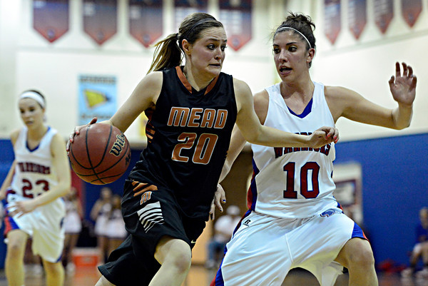 "Mead's Allison Majerus (20) drives past Centaurus' Gianna Manfredini (10) during the game at Centaurus High School on Friday, March 1, 2013. Centaurus beat Mead 48-30. For more photos visit  <a href=""http://www.BoCoPreps.com"">http://www.BoCoPreps.com</a>.<br /> (Greg Lindstrom/Times-Call)"