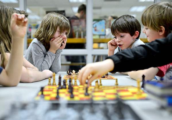 "From left, Abby Honc, 5, Joey Carter, 6, and Ryan Costello, 7, enjoy a game during chess club at the Longmont Public Library on Monday, Feb. 4, 2013. For more photos and a video, visit  <a href=""http://www.TimesCall.com"">http://www.TimesCall.com</a>.<br /> (Greg Lindstrom/Times-Call)"