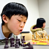 "Alex Fong, 7, eyes the board during chess club at the Longmont Public Library on Monday, Feb. 4, 2013. For more photos and a video, visit  <a href=""http://www.TimesCall.com"">http://www.TimesCall.com</a>.<br /> (Greg Lindstrom/Times-Call)"