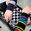 "Kylie Dirks, 10, and Joe Barham, 12, reset the board after a game during chess club at the Longmont Public Library on Monday, Feb. 4, 2013. For more photos and a video, visit  <a href=""http://www.TimesCall.com"">http://www.TimesCall.com</a>.<br /> (Greg Lindstrom/Times-Call)"