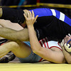 Longmont's Jaime Ramos Vega pins Weld Central's Logan Longworth in their 195 pound championship match during the Class 4A region 2 wrestling tournament Saturday Feb. 16, 2013 at Frederick High School. (Lewis Geyer/Times-Call)