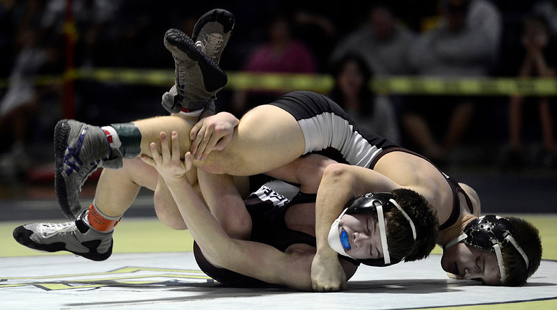 Fort Morgan's Ian Wingstrom gets on top of Berthoud's Jimmy Fate in their 126 pound match during the Class 4A region 2 wrestling tournament Saturday Feb. 16, 2013 at Frederick High School. (Lewis Geyer/Times-Call)