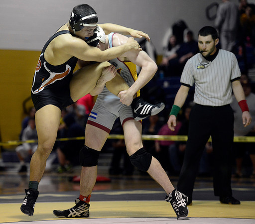 Mead's Gabe Alvarado and Windsor's Joseph Keller wrestle in their 170 pound championship match during the Class 4A region 2 wrestling tournament Saturday Feb. 16, 2013 at Frederick High School. (Lewis Geyer/Times-Call)