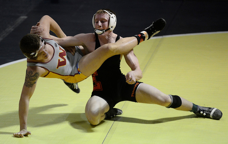 Erie's Ladd Bunker and Windsor's Vinny Gonzales battle in their 160 pound championship match during the Class 4A region 2 wrestling tournament Saturday Feb. 16, 2013 at Frederick High School. (Lewis Geyer/Times-Call)