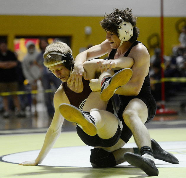 Roosevelt's Jace Lopez handles Fort Morgan's Jacob Gerken in their 138 pound championship match during the Class 4A region 2 wrestling tournament Saturday Feb. 16, 2013 at Frederick High School. (Lewis Geyer/Times-Call)