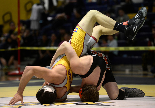 Mead's Kyle Couch and Windsor's Cosme Martinez wrestle in the 182 pound championship match during the Class 4A region 2 wrestling tournament Saturday Feb. 16, 2013 at Frederick High School. (Lewis Geyer/Times-Call)