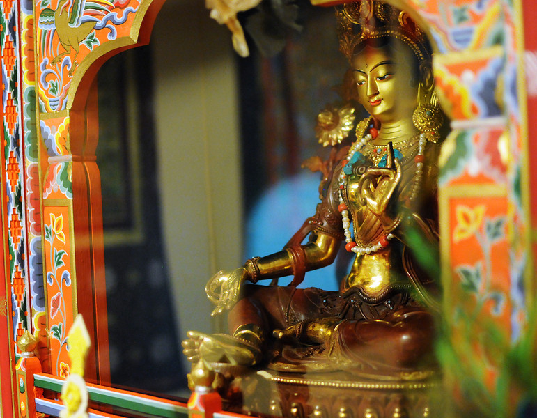The Green Tara, a female representation of a Buddhist deity, is the centerpiece of the recently consecrated shrine at the Drukpa Mila Center in southwest Longmont, August 29, 2010. (Bradley Wakoff/Times-Call)