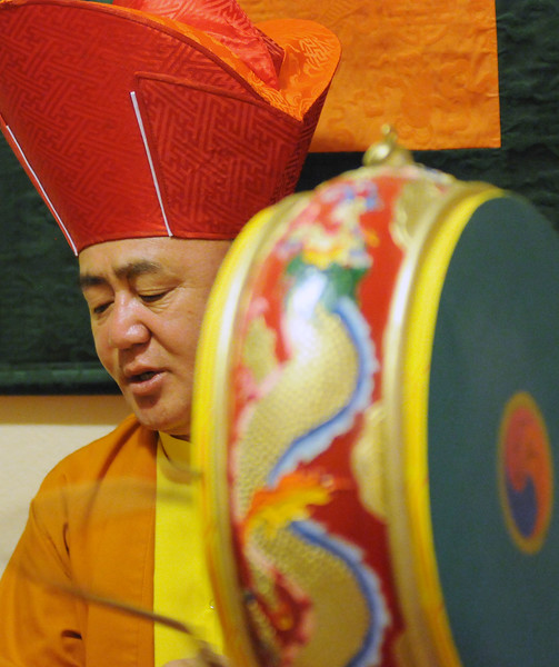 Lama Karma Namgyel uses a ceremonial drum to consecrate the Twenty-One Taras shrine at the Drupka Mila Center in Longmont, August 28, 2010. (Bradley Wakoff/Times-Call)