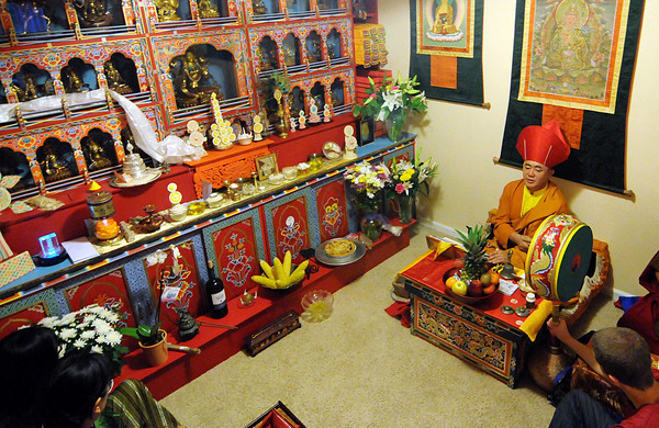 "Led by Lama Karma Namgyel, right, The Drukpa Mila Center consecrates their new ""Twenty One Taras"" shrine, August 29, 2010. The statues, or tara, in the shrine were commissioned from artists in Nepal and the shrine's woodwork was hand-cut and assembled by a craftsman from Bhutan. (Bradley Wakoff/Times-Call)"