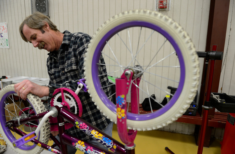 "Volunteer Rick Mueller services a bicycle during the annual Y-Pals Holiday Party and Longmont Bicycle Giveawaty at the Ed & Ruth Lehman YMCA, 950 Lashley St., Saturday Dec. 15, 2012. Nearly 580 bikes were collected through the annual holiday bike program sponsored by Bicycle Longmont. TO VIEW A VIDEO AND SLIDESHOW VISIT  <a href=""http://WWW.TIMESCALL.COM"">http://WWW.TIMESCALL.COM</a> (Lewis Geyer/Times-Call)"