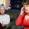 Jenifer Deeter wipes away tears while discussing the death of her mother, Mary Ann Bryan, with family including her grandmother, Darlene Allen, left, on Thursday, Jan. 10, 2013. <br /> (Greg Lindstrom/Times-Call)