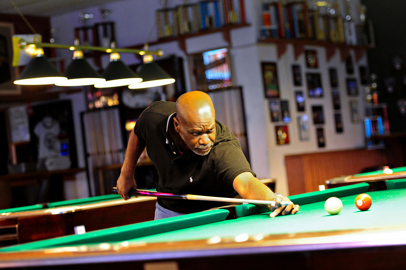 Longmont resident Dennis Moore shoots pool at A Bit of Billiards Sports Bar & Grill on Monday, Feb. 18, 2013.<br /> (Greg Lindstrom/Times-Call)