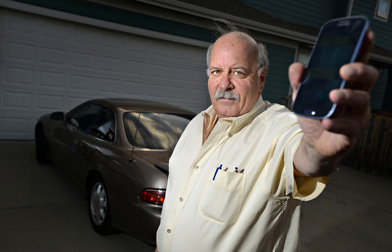 """Paul Ferruzza, 63, is the first motorist in Longmont to be ticketed in suspicion of texting while operating a motor vehicle.  He plans to fight the ticket in court.  Ferruzza is pictured at his home in Longmont on Wednesday, Dec. 5, 2012. For a video visit  <a href=""""http://www.TimesCall.com"""">http://www.TimesCall.com</a>.<br /> (Greg Lindstrom/Times-Call)"""