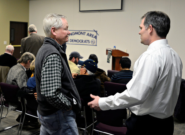 State Rep. Mike Foote, right, chats with Jeff Custer, left, before the start of the Longmont Area Democrats' meeting at Front Range Community College in Longmont on Wednesday, March 6, 2013.<br /> (Greg Lindstrom/Times-Call)