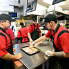 Joseph Chavez, right, prepares an order during a training session at Taco John's in Longmont on Monday, Jan. 21, 2013. <br /> (Greg Lindstrom/Times-Call)