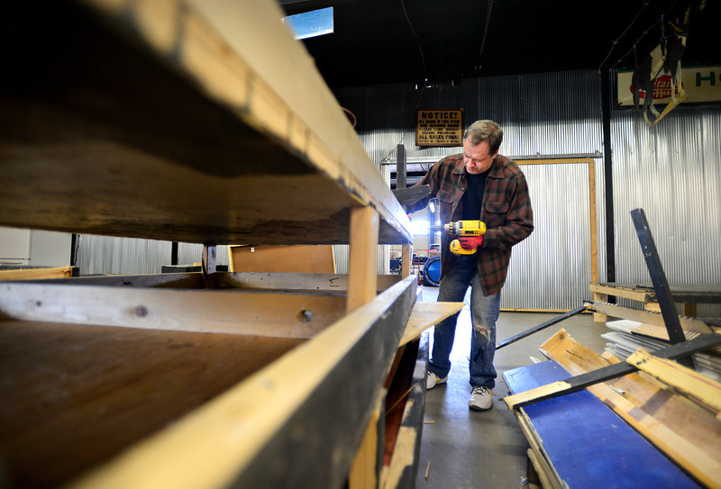 Colorado Actors Theatre owner Robert Bubon builds a stage at the company's new location at the Pacific Events Center, 1330 Main St. in Longmont, on Thursday, March 7, 2013.<br /> (Greg Lindstrom/Times-Call)