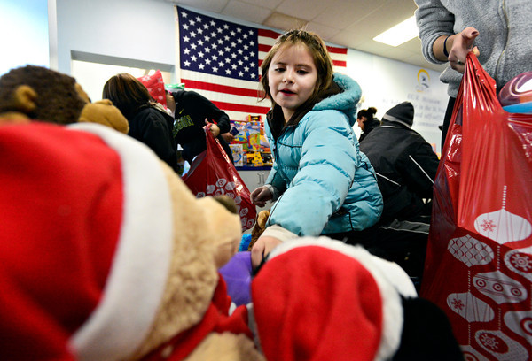 Anabel Monge, 7, picks out a toy stuffed animal at the OUR Center in Longmont on Tuesday, Dec. 25, 2012. The toys were donated by Left Hand Brewing Co.<br /> (Greg Lindstrom/Times-Call)