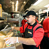 Chris Cisneros prepares an order during a training session at Taco John's in Longmont on Monday, Jan. 21, 2013. <br /> (Greg Lindstrom/Times-Call)